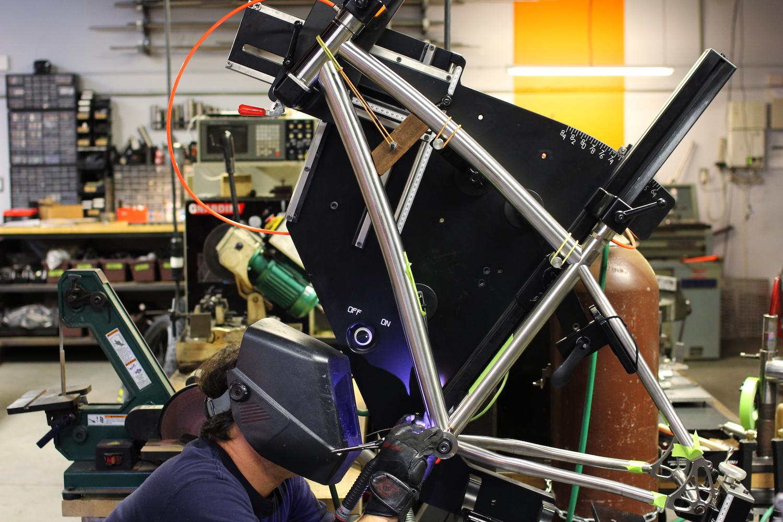 Jamie carefully tack-welding the frame together.