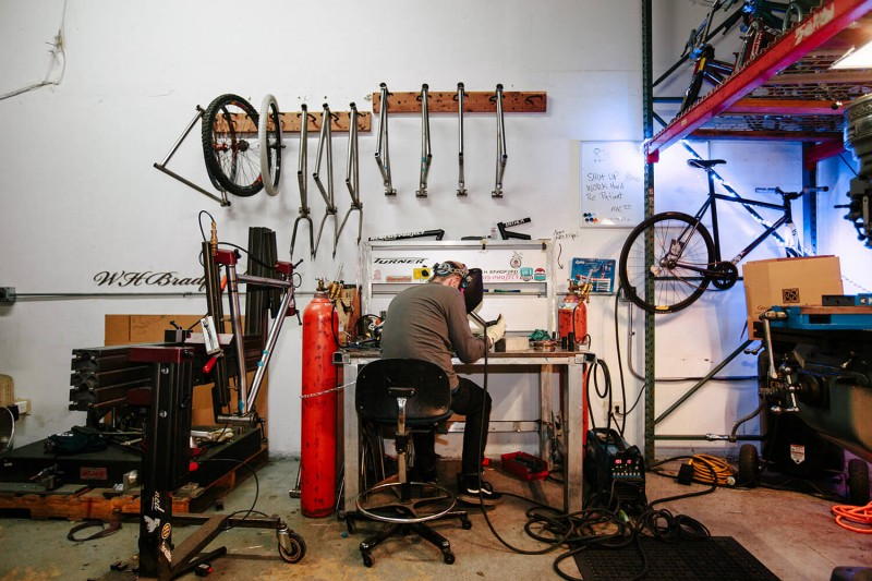 Brad Hodges of W.H. Bradford Design welding a bike frame. Photo by Angel Perez