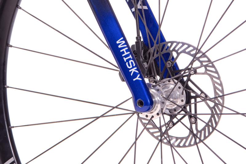 Whisky Select - Calfee Tetra Adventure Classic Bike - Closeup of Fork, front hub, and brake rotor
