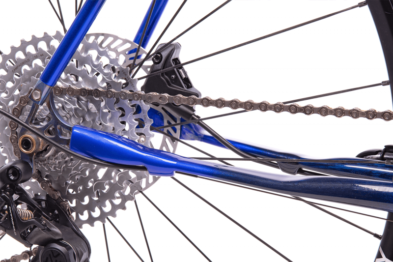 Whisky Select - Calfee Tetra Adventure Classic Bike - Closeup of cassette, chain, and rear derailleur